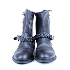 """This Golden Goose black short biker boot is a rigid leather ankle boot with decorative buckled straps & wool fleece lining. The boot has a 6.25"""" shaft with fleece lining and a 1"""" rubber heal and is 100% italian leather."""