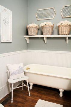 Farmhouse design bathroom decor ideas wainscoating clawfoot tub open shelf storage baskets