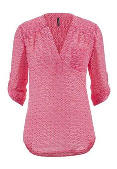 A brightly colored blouse is always welcome in my closet. Like the subtle pattern in this one.