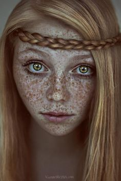 She looks just like a real-life version of Rapunzel from Tangled + freckles.