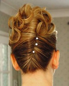 A french twist with curled ends instead of swirling them in with the twist.