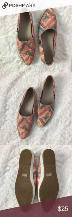 Multi color Sanuk Flats Multi-colored, ikat print Sanuk flats in excellent condition. Fabric has a faded appearance that is intentional. Size 6.5. Please ask any questions you may have prior to purchase. Sanuk Shoes Flats & Loafers