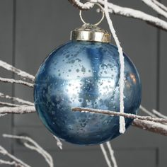 These gorgeous indigo stone effect glass baubles are the perfect way to update your Christmas decorations this year.We think that these will work beautifully with other cooler toned decorations to create a magical winter wonderland.These will look also make a wonderful display piled up in a bowl.