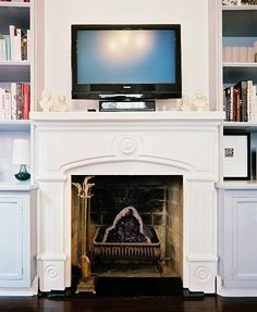 fireplace - i like the TV mounted on top.