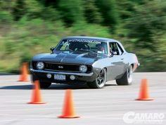 1st generation Camaro doing a little auto crossing.