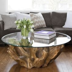 This solid teak root coffee table is a sculptural piece. Each one is very unique and beautiful.