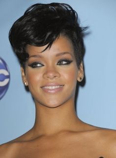 Rihanna is well known for her trendy hairstyles, and this one sided short Afro hairstyle is definitely one of the trendiest.