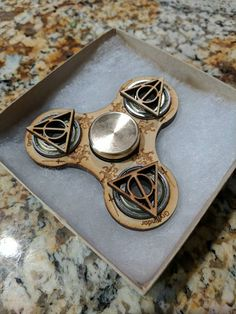 Laser Cut Harry Potter Themed Spinner Spinners are hand made to order so please allow 1-5 business days for shipment Bearing is a NEAL BlackOut Ceramic Bearing Spinner is cut from 1/4 Birch Plywood Bearing Caps allow for easier holding of the spinner, as well as spinning the spinner on flat surface