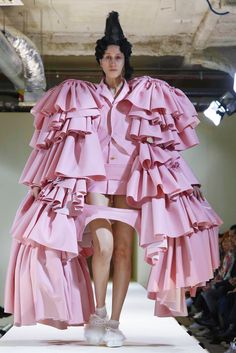 """Rei Kawakubo: Ms. Kawakubo's work..has to do..with drawing unexpected but powerful connections in entirely visceral ways via the stuff that covers the body. Which, in this case, had to do with a reminder of a time that was """"all about revolution,"""" said Mr. Joffe: the French, American, & Industrial Revolutions. A time when the 99% rose up against the 1% & machines changed the world economy."""