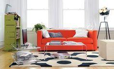 cool living room with an orange sofa and acrylic table