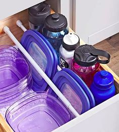 Affordable Kitchen Storage Ideas: Rethink how you use tension curtain rods. Place rows of the affordable window-treatment hardware inside a cabinet to keep plastic food-container lids, baking sheets, or serving trays upright and organized. Kitchen Cupboard Organization, Kitchen Storage Hacks, Kitchen Cupboards, Kitchen Pantry, New Kitchen, Storage Ideas, Cupboard Organizers, Kitchen Decor, Organized Kitchen
