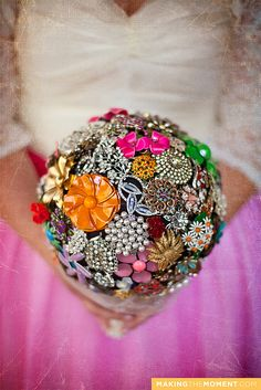 Old buttons and brooches in a bouquet.
