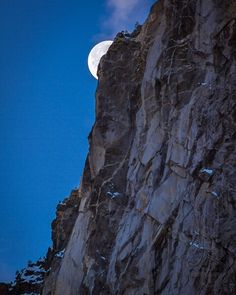 Full moon disappearing behind the cliff face...