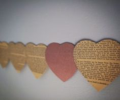 Heart Bunting - recycled from old books and sewn together www.madebykatyjan... #bunting #hearts #recycle #weddings #decorations #books #rustic