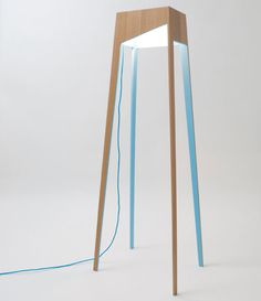 The Fiss Family: four wood tables featuring a downward glow & ambient light | Rui Alves