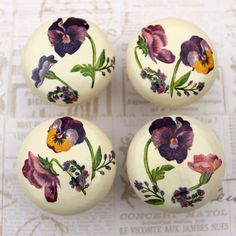 Wooden door knobs with pansy design by witchcorner on Etsy, $24.00