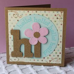 Letter cut outs with flower dotting the i.