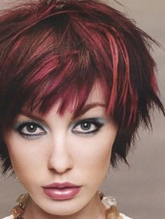 I don't think I could ever pull this off, but I LOVE the cut and color here.  LOVE!