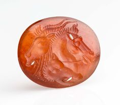 Oval gem with three animal heads. Roman 1st century B.C. - 1st century A.D.
