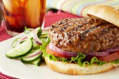 Parmesan cheese adds a savory flavor to these juicy beef burgers, perfect for a summer holiday or weeknight meal when you don't want to stray from the usual barbecue fare, but you still want a unique meal. Serve with your favorite fixings to keep the meal classic.