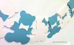 Cute teddy bear garland made from smooth 185gsm cardstock. 10 contrasting bears in a row, holding hands and held together with white brads. Each