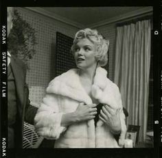 Marilyn with photographer Cecil Beaton, February 1956.