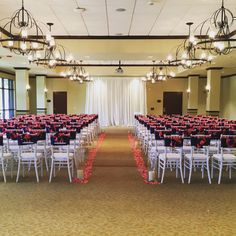 Coral accents for a colorful ceremony in City Centre at Quail Valley with @lbl_event_rentals