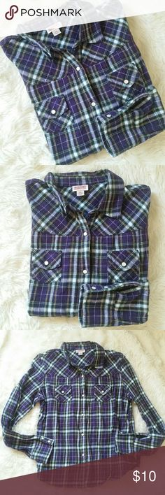 "Mossimo Flannel Plaid Snap Button Up Size Large Purple, green and white flannel. Soft and cozy. White pearl button snap ups at the front and cuffs. Double pockets at the bust. Soft 100% cotton. Preowned in good condition with no rips, holes, tears or stains.   Pit to Pit 20.5"" Top of shoulder to bottom hem 23"" Mossimo Supply Co. Tops Button Down Shirts"