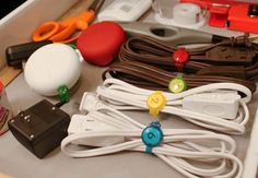 Dotz Reusable Cable Straps  This product comes to those of you who often have difficulty managing the identity of your cables. Dotz Cable Straps come in multiple colors and behave as a permanent zip-tie solution. You can label each of your important cords and never lose track of them again.