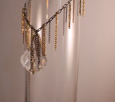 Recycled Chandelier Crystal with Chain Work.   $59.95  pursuasion.designs@gmail.com