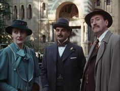 A dapper trio from Agatha Christie's Poirot: Miss Lemon, Hercule Poirot, and Chief Inspector Japp. Agatha Christie's Poirot, Hercule Poirot, Death In The Clouds, David Suchet, Miss Marple, Bbc Tv, Mystery Parties, Sherlock Holmes, Tv Shows