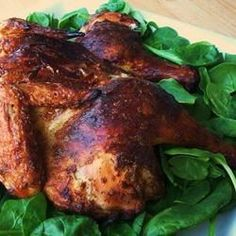 Butterflied to make it easy to grill a whole chicken, then seasoned beneath the skin with a sour cream-herb mixture, this preparation guarantees a juicy, grilled chicken with lots of flavor.  Allrecipes.com