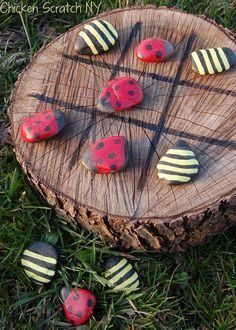 Ladybug and Bumble Bee Tic-Tac-Toe - Lady Bird & Bumble Bee Tic-Tac-Toe game - hand paint rocks and a tree stump for a home made outdoor game. Durable, low cost, fun + garden art! More creative ideas @ http://themicrogardener.com/gardens-for-kids/ | The Micro Gardener