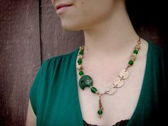 This necklace features hand engraved copper and a beautiful green wooden fish, porcelain beads, faceted green glass beads, small faceted crystals, and copper spacer beads. Asian Fish Necklace with Wood Bead Ceramic Beads by RococoRiche, handmade jewelry available on Etsy!