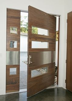 Wow! The metal plate across the middle of the door/sidelight really make this pivot door pop! Find out more about pivot doors or design your own at http://www.pivotdoorcompany.com/Exterior-Doors/.