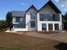 Alpine style balcony. White framing of lower floors, grey to gable end. white and cladding gable front house uk eu - Google Search