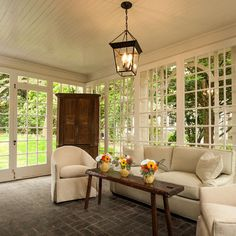 Sun Room Design Ideas, Pictures, Remodel, and Decor - page 6.  This sun room is very similar to ours.  Our ceiling and windows are the same.  I think I like the white paint.   I want to pull down the little strip of blue wall paper and probably paint it white to match the ceilings and windows.