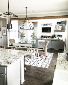 Farmhouse style open layout with kitchen, dining room and living room #farmhousestyle #greatroom
