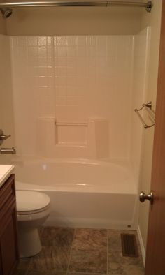our spacious oval tubshower with curved shower bar the shower bar has an