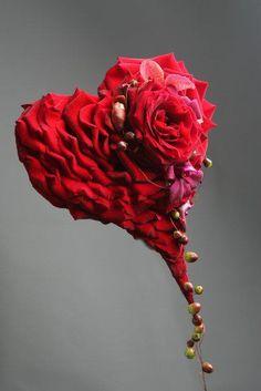 Per Benjamin. red rose heart bouquet.