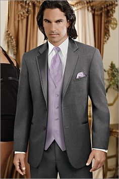 To make this outfit look really nuvo-chic, add JUST a grey patterned tie and a plain-front white tux shirt. It brings a subtle elegance to this tuxedo which makes it a better choice than just a suit. The satin framing makes all the difference!