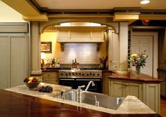 Seriously beautiful cooking alcove with beadboard paneling, corbels and white tile backsplash.