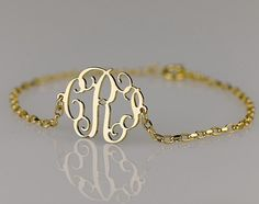 http://www.etsy.com/listing/100881567/monogram-bracelet-06-inch-side-attached?ref=sr_gallery_39_search_query=monogram+gold+bracelet_view_type=gallery_ship_to=ZZ_min=0_max=0_ref=auto3_search_type=handmade    Can I have a ring and necklace just like it?! :)