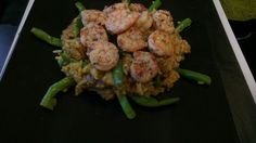 Crunchy shrimps on a curry rice bed. Melting in your mouth.