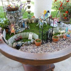 Fairy village in a bird bath
