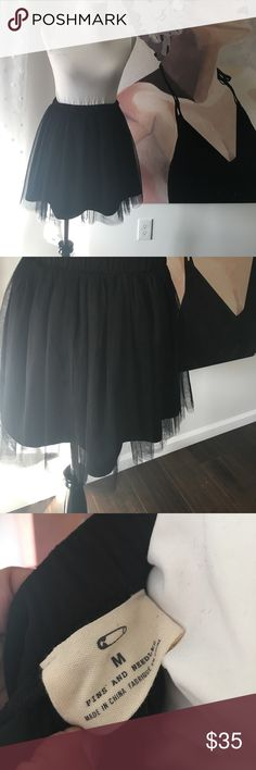 Pins & Needles Black Tutu Skirt Size M Super cute tutu skirt for summer. Could be cute worn with a cropped top, bodysuit, graphic tee, sneakers, balarina flats.... the choices are endless and all so stylish. The rule on this skirt is very soft. Not rough at all. Elastic waist.  Size M Pins & Needles Skirts Circle & Skater