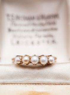 This Edwardian-style pearl engagement ring is a timeless beauty for a vintage loving bride-to-be.