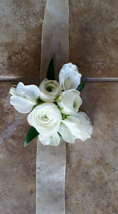 White ranunculus and sweet pea wrist corsage by Eden's Echo