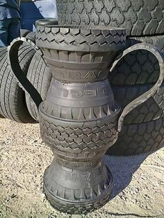 Tire vase Fun yard decorations and artworks are wonderful ways to reuse and recycle old tires