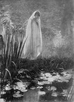 A Veiled Beauty by a Lilly Pond. France. Circa 1900-1910. Photo by Emile Constant Puyo (1857-1933).
